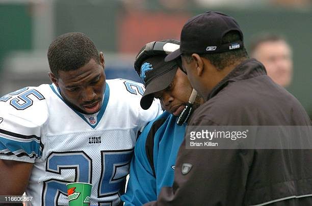Detroit Lions cornerback Fernando Bryant confers with defensive backs coach Clayton Lopez and defensive coordinator Donnie Henderson during the game...
