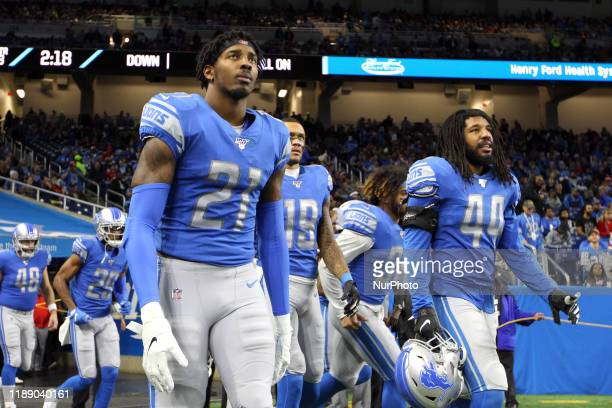 Detroit Lions cornerback Justin Coleman and Detroit Lions linebacker Jalen Reeves-Maybin walk onto the field during the second half of an NFL...