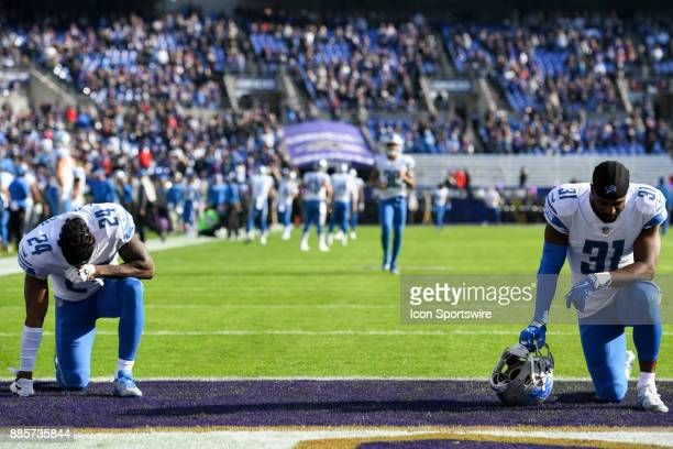 Detroit Lions cornerback Nevin Lawson and defensive back DJ Hayden kneel in the end zone on December 3 at MT Bank Stadium in Baltimore MD The...