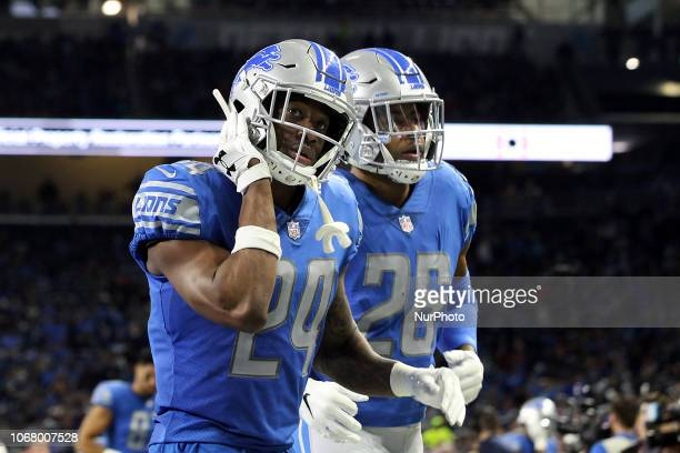 Detroit Lions cornerback Nevin Lawson leaves the field flanked by Detroit Lions defensive back DeShawn Shead at the end of the first half of an NFL...