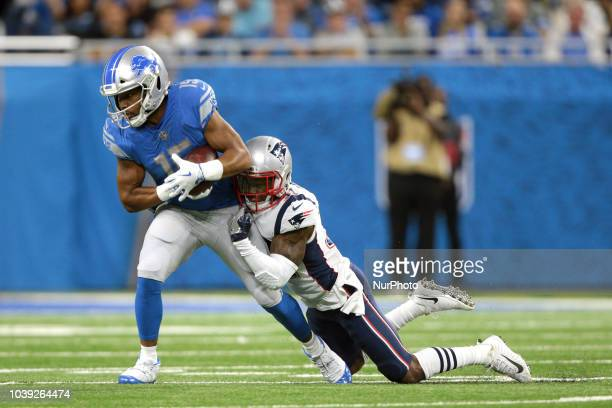 Detroit Lions cornerback Teez Tabor runs the ball against New England Patriots defensive back Jonathan Jones during the first half of an NFL football...