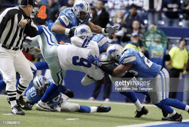 Detroit Lions defenders Corey Smith Paris Lenon and Kenoy Kennedy stop Dallas Cowboys quarterback Tony Romo short of the goal line late in the fourth...