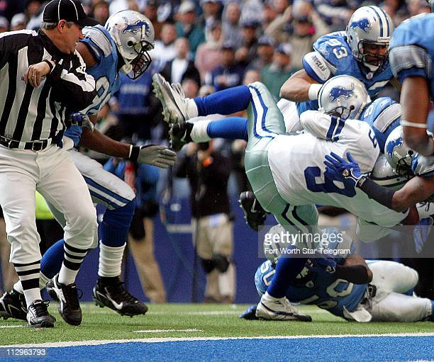 Detroit Lions defenders Kenoy Kennedy Corey Smith and Paris Lenon stop Dallas Cowboys quarterback Tony Romo short of the goal line late in the fourth...