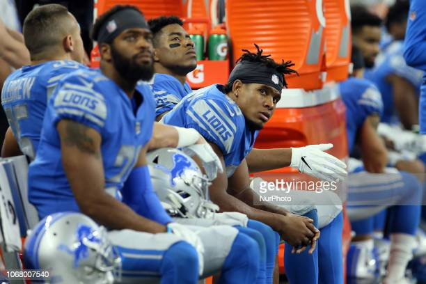 Detroit Lions defensive back Charles Washington watches from the bench during the second half of an NFL football game against the Los Angeles Rams in...