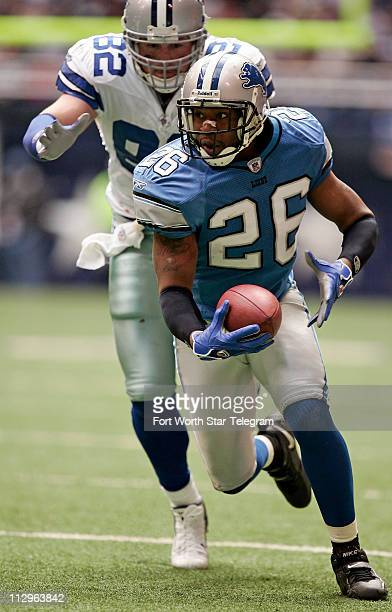 Detroit Lions defensive back Kenoy Kennedy returns an interception as Dallas Cowboys tight end Jason Whitten chases during game action The Lions...