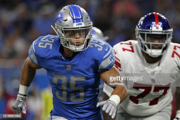 Detroit Lions defensive back Miles Killebrew runs a play during the second half of an NFL football game against the New York Giants in Detroit...