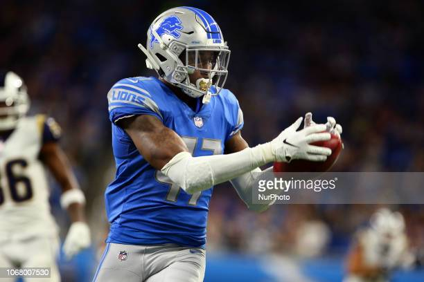 Detroit Lions defensive back Tracy Walker carries the ball during the first half of an NFL football game against the Los Angeles Rams in Detroit...