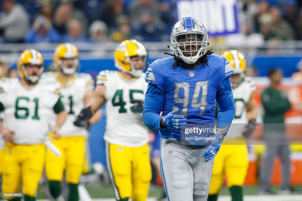 Detroit Lions defensive end Ezekiel Ansah (94) heads to the sideline after a play during a game between the Green Bay Packers and the Detroit Lions on December 31, 2017 at Ford Field in Detroit, Michigan.