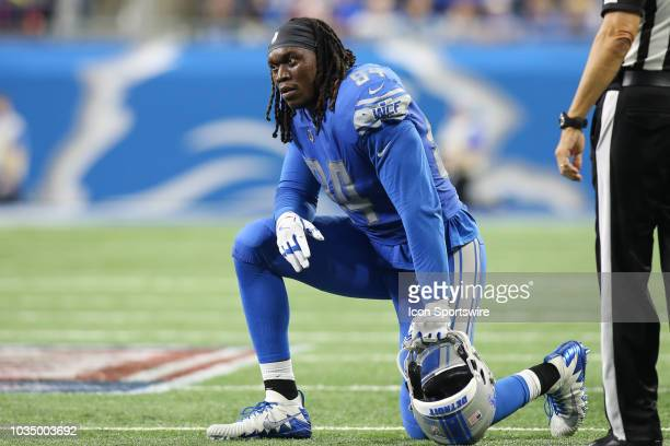Detroit Lions defensive end Ezekiel Ansah kneels during an injury timeout during a regular season game between the New York Jets and the Detroit...