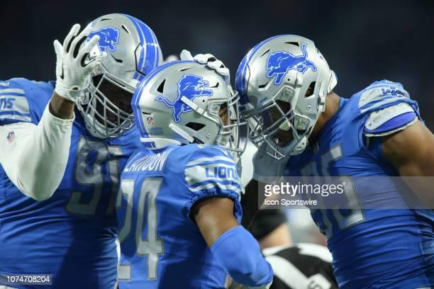 Detroit Lions defensive tackle A'Shawn Robinson , Detroit Lions corner back Nevin Lawson , and Detroit Lions defensive end Romeo Okwara celebrate a...