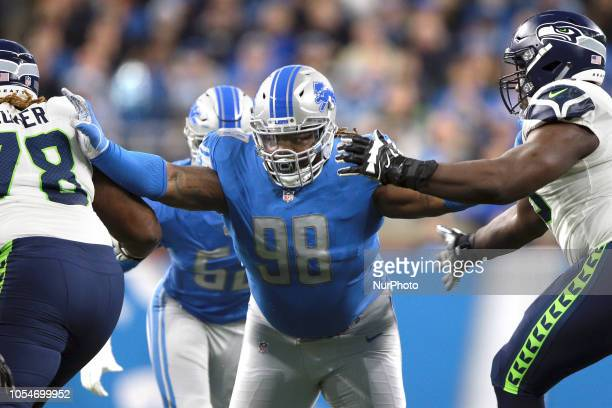 Detroit Lions defensive tackle Damon Harrison defends against the Seattle Seahawks during the first half of an NFL football game in Detroit Michigan...