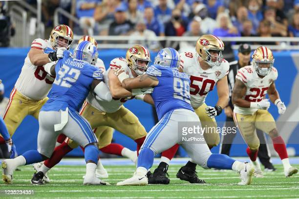 Detroit Lions defensive tackle John Penisini holds the line against San Francisco 49ers offensive tackle Daniel Brunskill during an NFL football game...