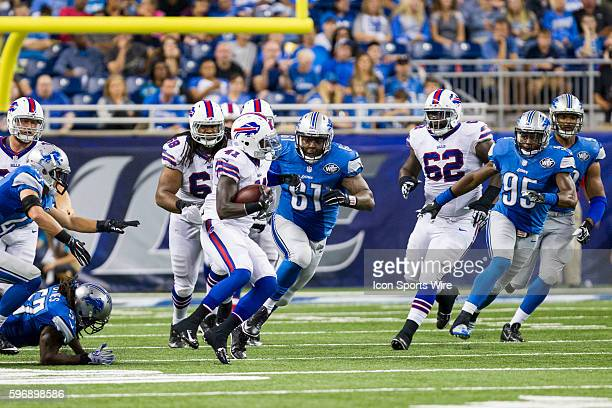 Detroit Lions defensive tackle Kerry Hyder and Detroit Lions linebacker Brandon Copeland chase after Buffalo Bills running back Cierre Wood during...