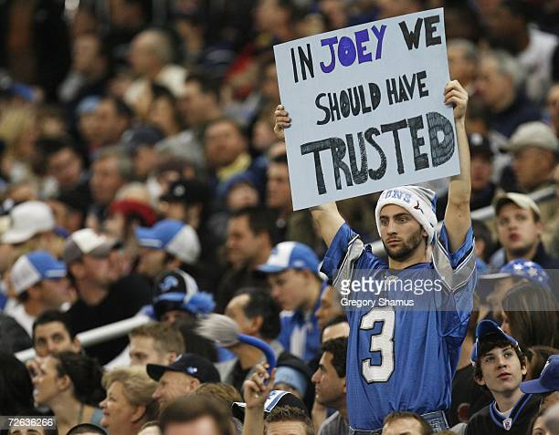 Detroit Lions fan holds up a sign supporting Joy Harrington of the Miami Dolphins on his return to Detroit on November 23 2006 at Ford Field in...