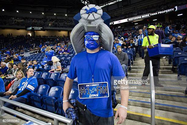 Detroit Lions fan is seen wearing a foam motor hat during game action between the Minnesota Vikings and the Detroit Lions on Thanksgiving Day on...