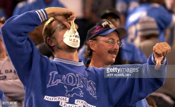 Detroit Lions fan James Halley of Novi Michigan shows his displeasure with the Detroit Lions as they play against the St Louis Rams at the Pontiac...