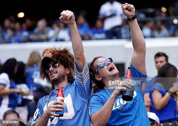 Detroit Lions fans cheer from the crowd during second quarter the game between the Indianapolis Colts and the Detroit Lions at Lucas Oil Stadium on...