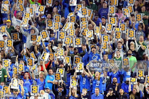 Detroit Lions fans wave 3rd down signs during the first half of an NFL football game against the Green Bay Packers in Detroit Michigan USA on Sunday...