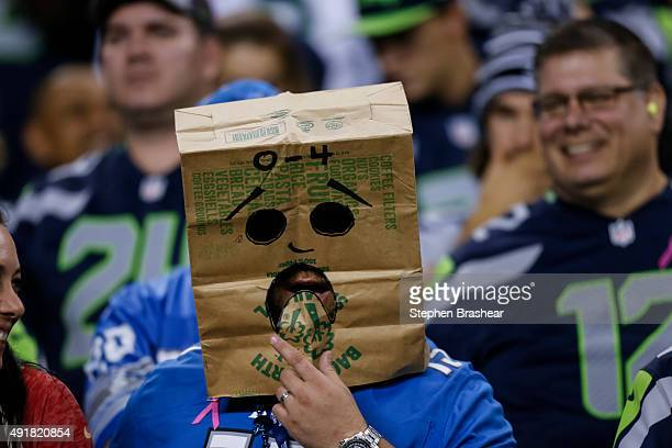 Detroit Lions fans wears a bag on his head during a football game between the Detroit Lions and the Seattle Seahawks at CenturyLink Field on October...