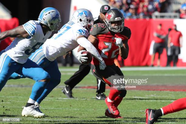 Detroit Lions free safety Glover Quin forces Tampa Bay Buccaneers running back Doug Martin to fumble the ball in the second quarter of the NFL game...