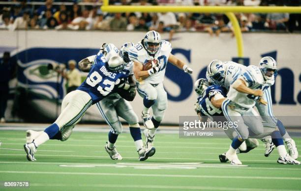 Detroit Lions fullback Cory Schlesinger rumbles through the hold during a 28-20 victory over the Seattle Seahawks on September 12 at the Kingdome in...