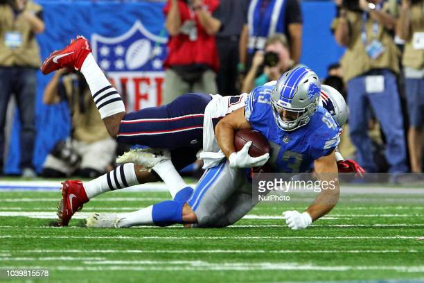 Detroit Lions fullback Nick Bellore is tackled by New England Patriots linebacker Elandon Roberts during the second half of an NFL football game...