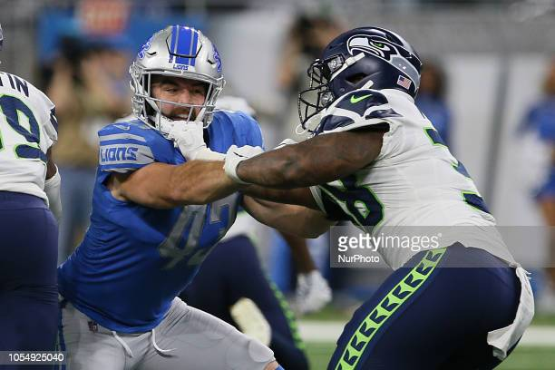 Detroit Lions fullback Nick Bellore rushes against Seattle Seahawks fullback Tre Madden during the first half of an NFL football game against the...