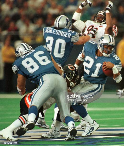 Detroit Lions Greg Hill tries to gain some yards as his teammates David Sloan and Cory Schlesinger hold back Chicago Bears defenders Warrich Holdman...