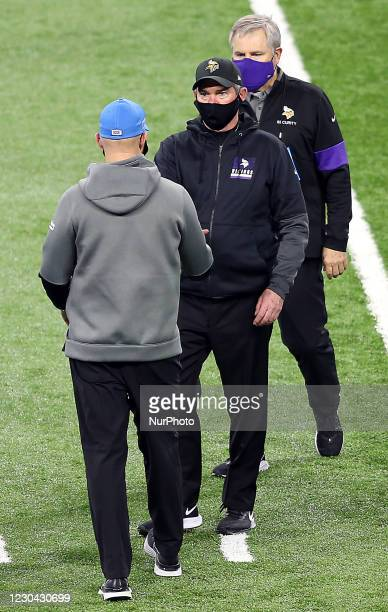 Detroit Lions head coach Darrell Bevell shakes hands with Minnesota Vikings head coach Mike Zimmer at the conclusion of an NFL football game between...
