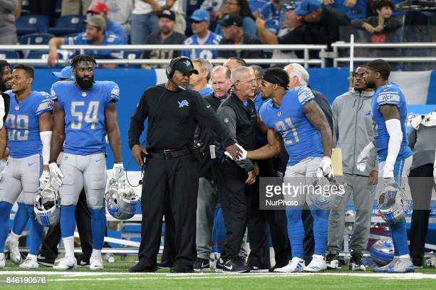 Detroit Lions head coach Jim Caldwell and running back Ameer Abdullah celebrate the 35-23 victory over the Arizona Cardinals in Detroit, Michigan...
