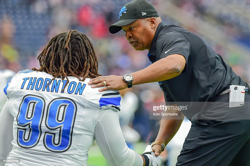 Detroit Lions head coach Jim Caldwell shakes the hand of Detroit Lions Defensive Tackle Khyri Thornton (99) before the NFL football game between the Detroit Lions and Houston Texans on October 30, 2016 at NRG Stadium in Houston, TX.