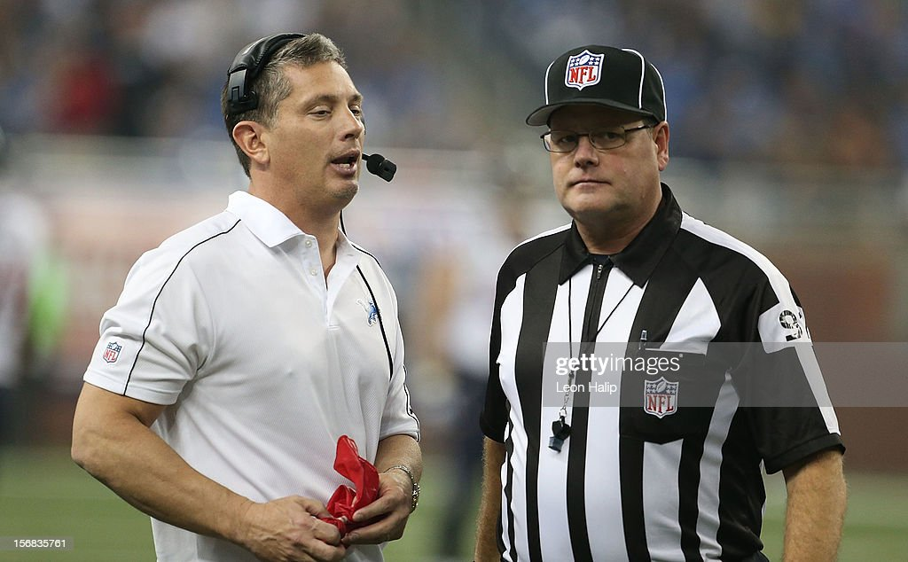Detroit Lions head coach Jim Schwartz (L) talks with NFL official Jerry Bergman during a disputed play during the game against the Houston Texans at Ford Field on November 22, 2012 in Detroit, Michigan. The Texans defeated the Lions 34-31.
