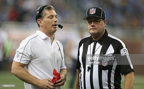 Detroit Lions head coach Jim Schwartz talks with NFL official Jerry Bergman during a disputed play during the game against the Houston Texans at Ford...