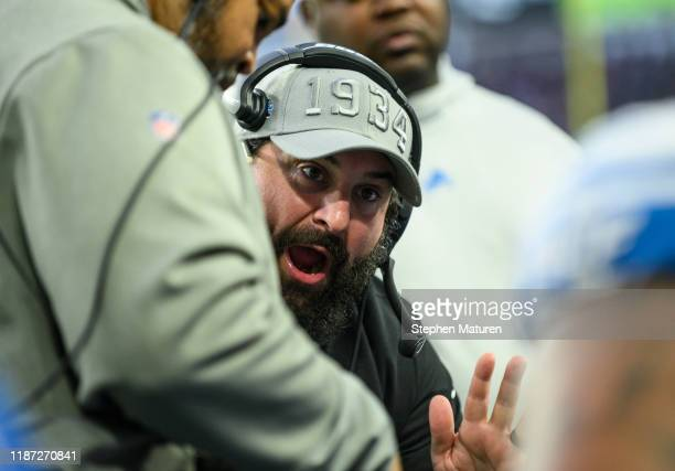 Detroit Lions head coach Matt Patrica speaks with players on the bench in the second quarter of the game against the Minnesota Vikings at US Bank...