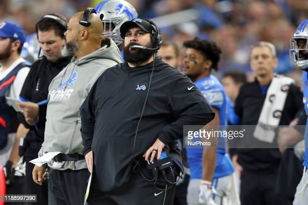 Detroit Lions head coach Matt Patricia looks at a replay on the screen during the first half of an NFL football game against the Tampa Bay Buccaneers...