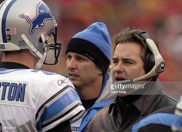 Detroit Lions head coach Steve Mariucci talks with quarterback Joey Harrington during a timeout against the Kansas City Chiefs December 14 2003 at...