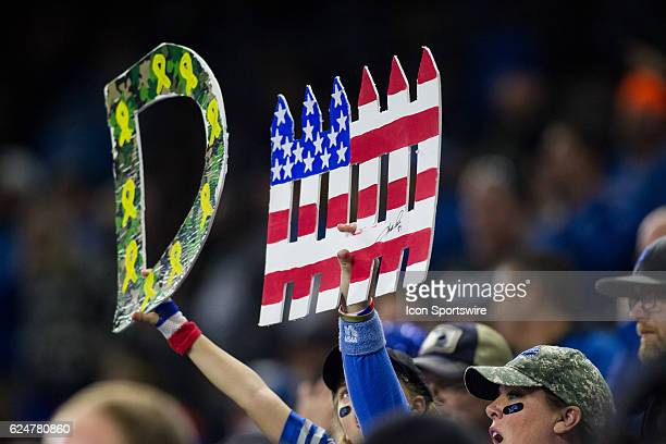 Detroit Lions hold up a letter 'D' and a 'fence' as they cheer on the Lions defense during game action between the Jacksonville Jaguars and the...
