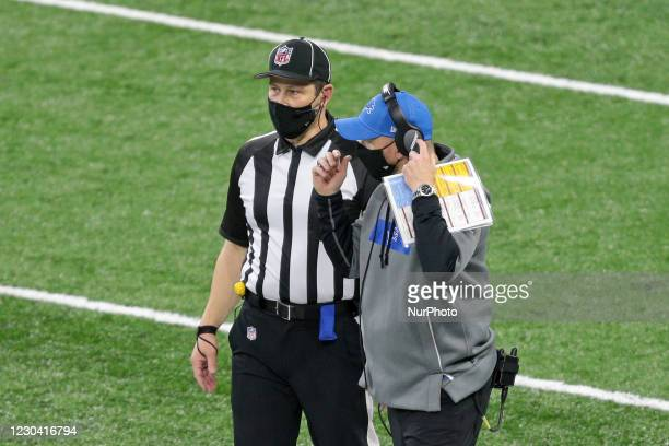 Detroit Lions interim head coach Darrell Bevell talks to umpire Mark Pellis during the first half of an NFL football game against the Minnesota...