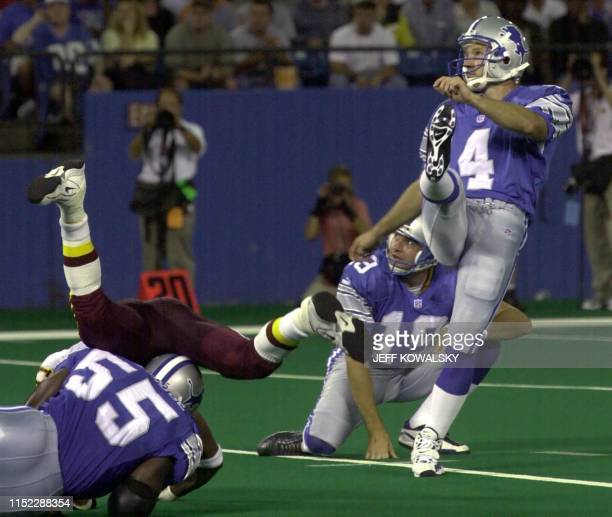 Detroit Lions kicker Jason Hanson watches his second field goal of the game with his place holder Jon Jett a as Lions linebacker Allen Aldridge holds...