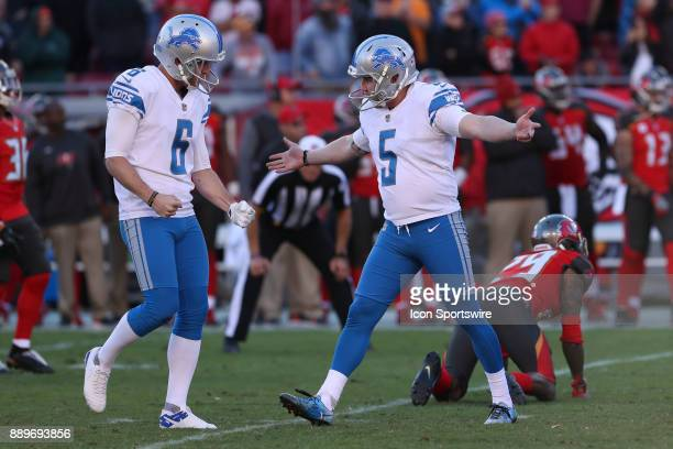 Detroit Lions kicker Matt Prater celebrates with Detroit Lions punter Sam Martin after kicking the game winning field goal in the fourth quarter of...