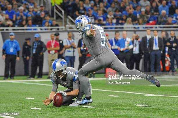Detroit Lions kicker Matt Prater kicks a field goal as Detroit Lions punter Sam Martin holds the ball during a game between the Chicago Bears and the...