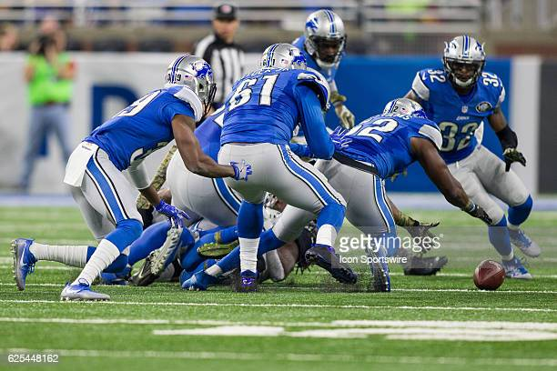 Detroit Lions linebacker Antwione Williams and his defensive teammates chase after a loose ball during game action between the Jacksonville Jaguars...