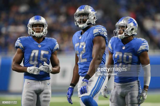 Detroit Lions linebacker Antwione Williams looks at the scoreboard along with teammates Detroit Lions safety Charles Washington and Detroit Lions...