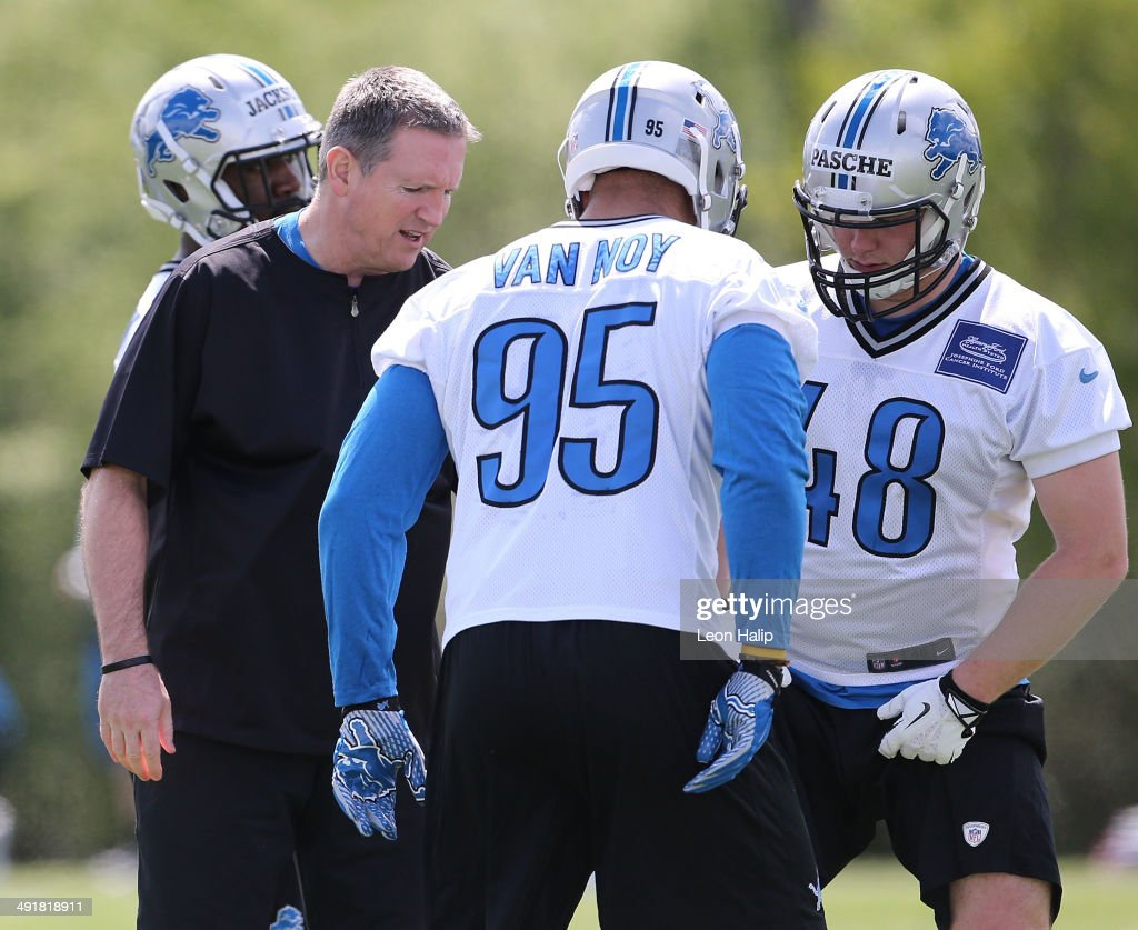 Detroit Lions linebacker coach Bill Sheridan gives instructions to Kyle Van Noy #95 and Brett Pasche #48 during Rookie Minicamp on May 17, 2014 in Allen Park, Michigan.