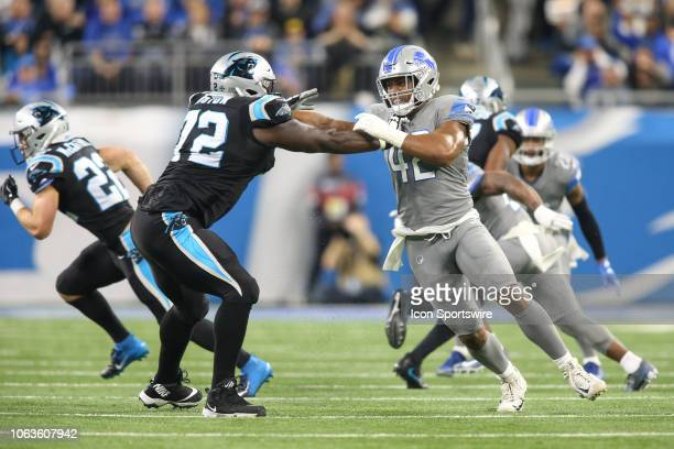 Detroit Lions linebacker Devon Kennard fights through a block by Carolina Panthers tackle Taylor Moton during a regular season game between the...