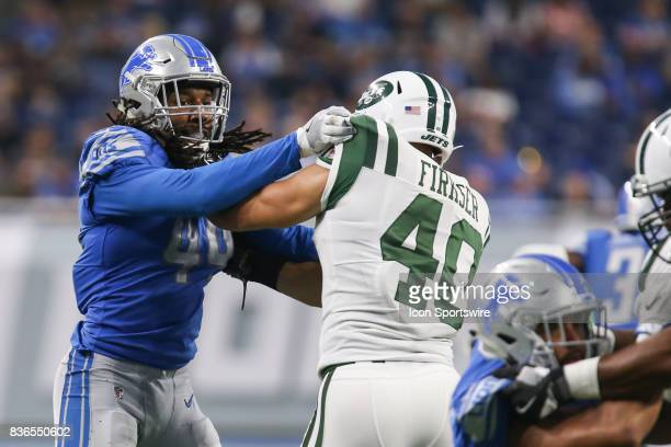 Detroit Lions linebacker Jalen Reeves-Maybin battles against New York Jets full back Anthony Firkser during a preseason game between the New York...