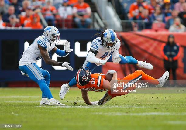 Detroit Lions Linebacker Jalen Reeves-Maybin puts a big hit on Denver Broncos Tight End Jeff Heuerman during a regular season game between the Denver...