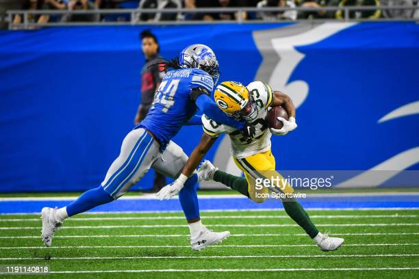 Detroit Lions linebacker Jalen Reeves-Maybin tackles Green Bay Packers running back Aaron Jones after a short gain during the Detroit Lions versus...