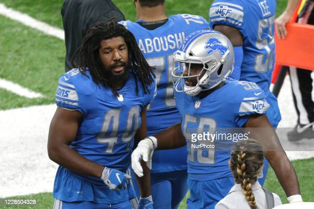 Detroit Lions linebacker Jalen Reeves-Maybin talks to inside linebacker Reggie Ragland during the first half of an NFL football game against the...