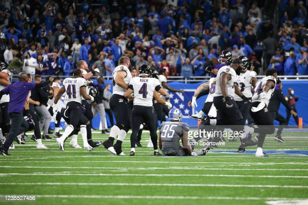 Detroit Lions linebacker Romeo Okwara sits on the turf watching the Baltimore Ravens team celebrating their win with a record game-winning 66-yard...